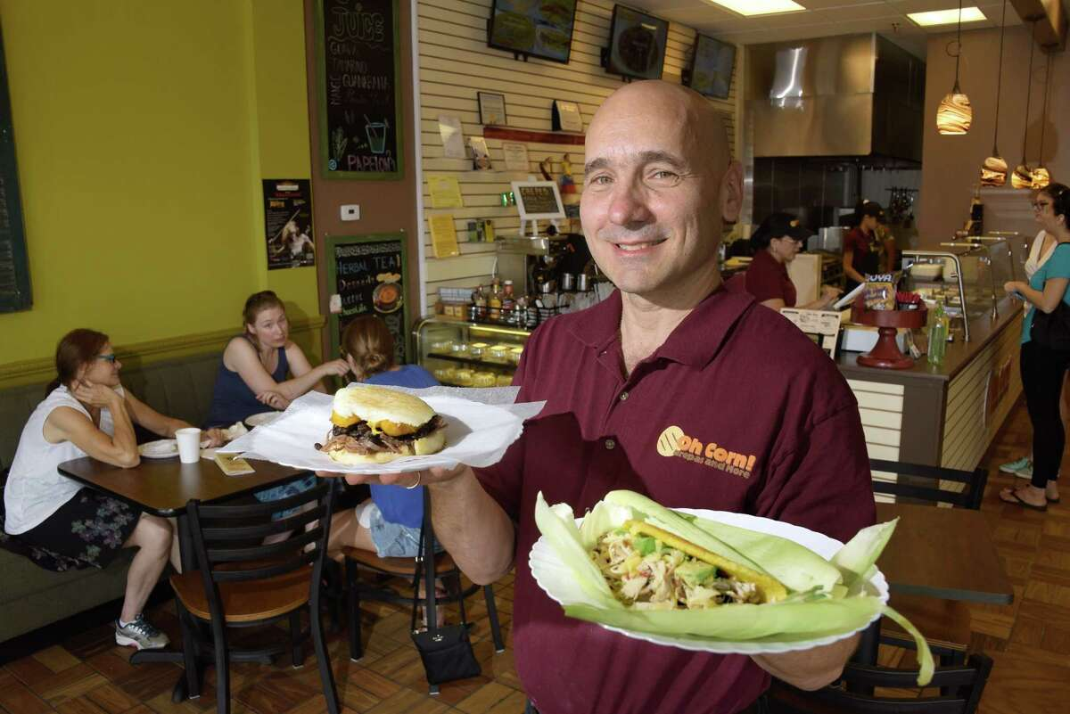 Restaurant owner Jose Theoktisto with orders of Arepa