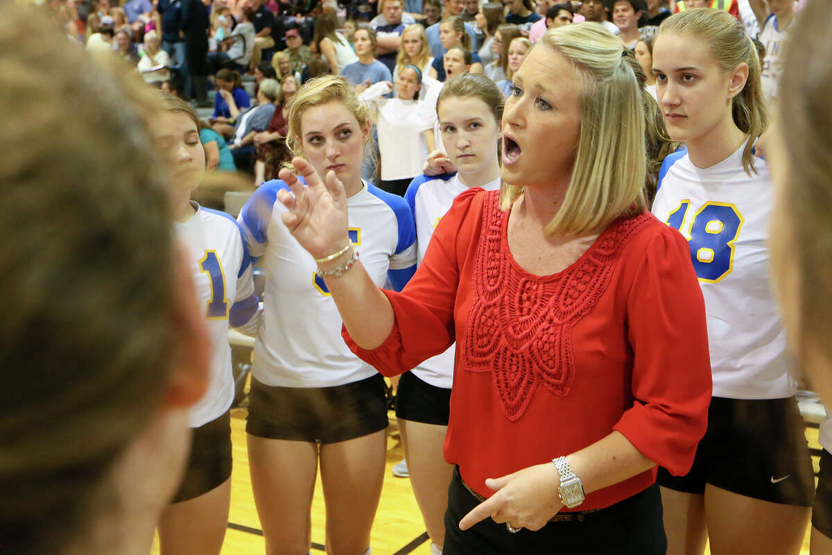 Alamo Heights coach Courtney Patton talks to the Lady Mules during a time out in their District 27-5A volleyball match at Boerne Champion on Oct. 20, 2015.