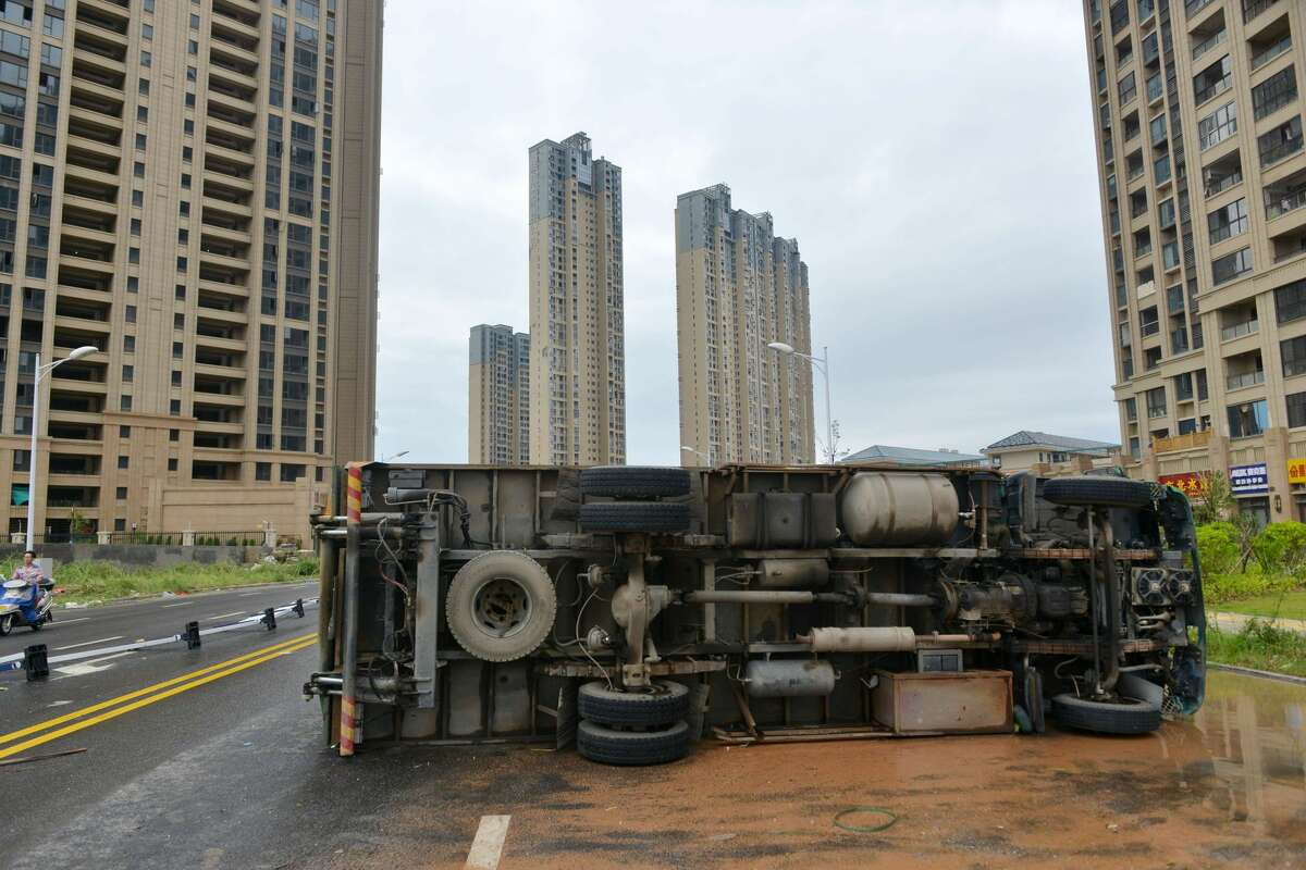 An overturned truck is seen on a street in Xiamen, China's eastern Fujian province, after Typhoon Meranti made landfall on September 15, 2016. Typhoon Meranti made landfall in Fujian early September 15 with winds up to 230kph, knocking out electricity in some areas and causing rail delays. / AFP / STR / China OUT (Photo credit should read STR/AFP/Getty Images)