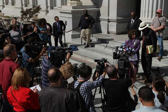 From left at the podium: Attorneys Pamela Price and Charles Bonner, during a news conference at the Frank H. Ogawa Plaza on Thursday, Sept. 15, 2016 in Oakland, Calif. Attorneys addressed members of the media about Jasmine, the sexually-exploited teen who went by the name Celeste Guap.