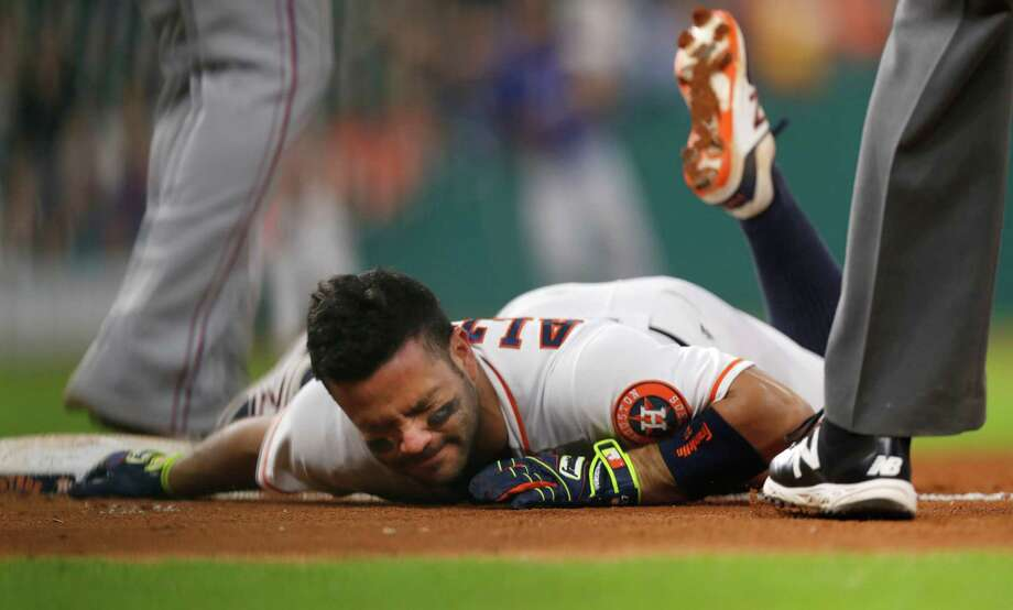 Houston Astros Jose Altuve (27) reacts after he was tagged out at first base following a single during the sixth inning of an MLB game at Minute Maid Park, Tuesday, Sept. 13, 2016 in Houston. ( Karen Warren / Houston Chronicle ) Photo: Karen Warren, Staff Photographer / 2016 Houston Chronicle
