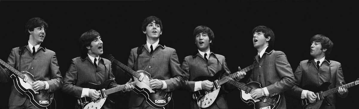 This Feb. 11, 1964 image provided by the David Anthony Fine Art gallery in Taos, N.M., shows a photograph of John Lennon and Paul McCartney taken by photographer Mike Mitchell during the Beatles first live U.S. concert at the Washington Coliseum. Mitchell?'s portraits of the Beatles are the centerpiece of a monthlong photography exhibition at the gallery. This marks the first time the images have been shown since their unveiling in 2011 at a Christie?'s auction in New York City. (AP Photo/David Anthony Fine Art, Mike Mitchell) ORG XMIT: AQ104