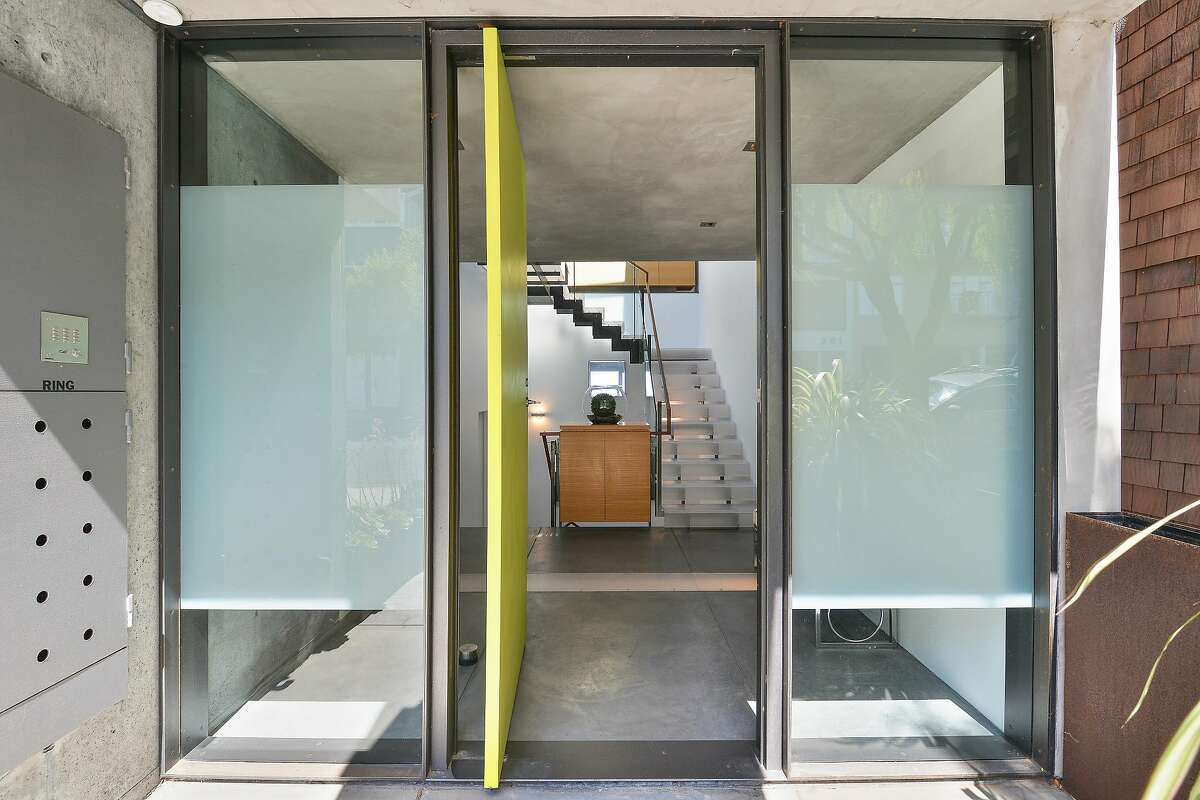 The level entry opens to a light-filled foyer and translucent staircase.