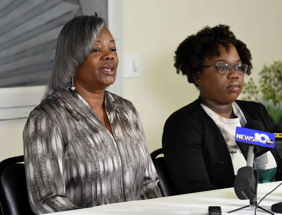 Gertha DePas, mother of Edson Thevenin, who was shot by Troy Police Sgt. French, left, is joined by her daughter-in-law Cinthia Thevenin during a press conference April 28, 2016, at the Empire Christian Center in Albany, N.Y.     (Skip Dickstein/Times Union) Photo: SKIP DICKSTEIN / 10036420A