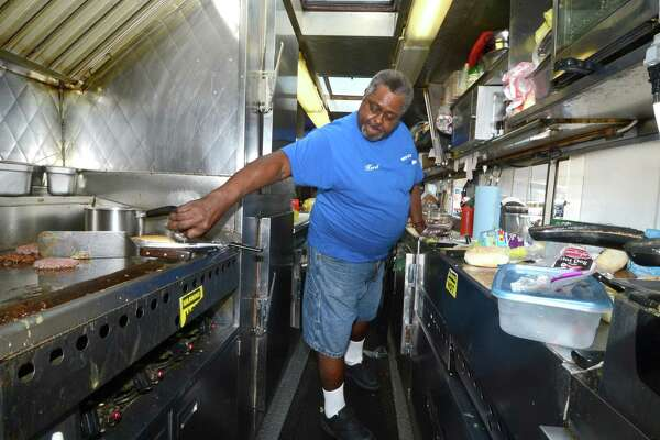 """Herb Edmondson, Owner, fills some lunch orders on a busy Thursday September 15, 2016 at his food Truck, Herb's Place at 120 Water St. in SoNo. Herb who has been in the same spot for just over 20 years says his loyal customers come fo his chili, grilled chicken and especially his home made pulled pork. Everything is made fresh from scratch because its """"what i like to do, get to know the customers because you see every walk of life"""". Herb plans to extend his hours a little later than the current Mon-Sat 7:30 to 2:00 when he gets some help. You can find him on Water St. tucked in next to Norwest Marine in Norwalk Conn."""