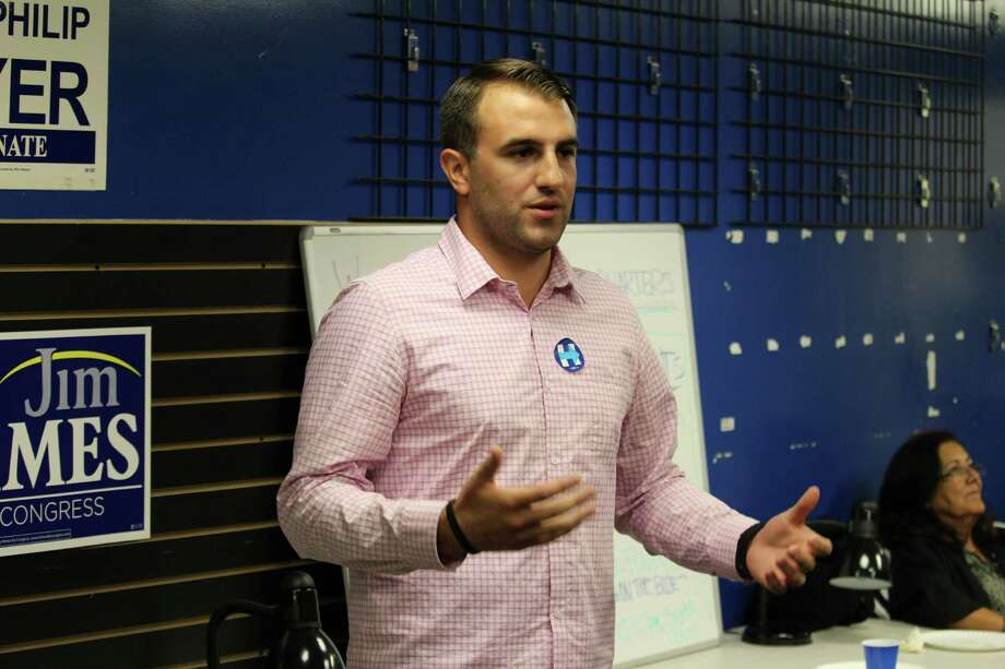 Tommy Hyde, state director at Hillary for America, speaks to a crowd of Westport Democrats on Clinton's strategies going forward in the state at Democratic Town Committee headquarters in Westport. Photo: Chris Marquette / Hearst Connecticut Media / Westport News
