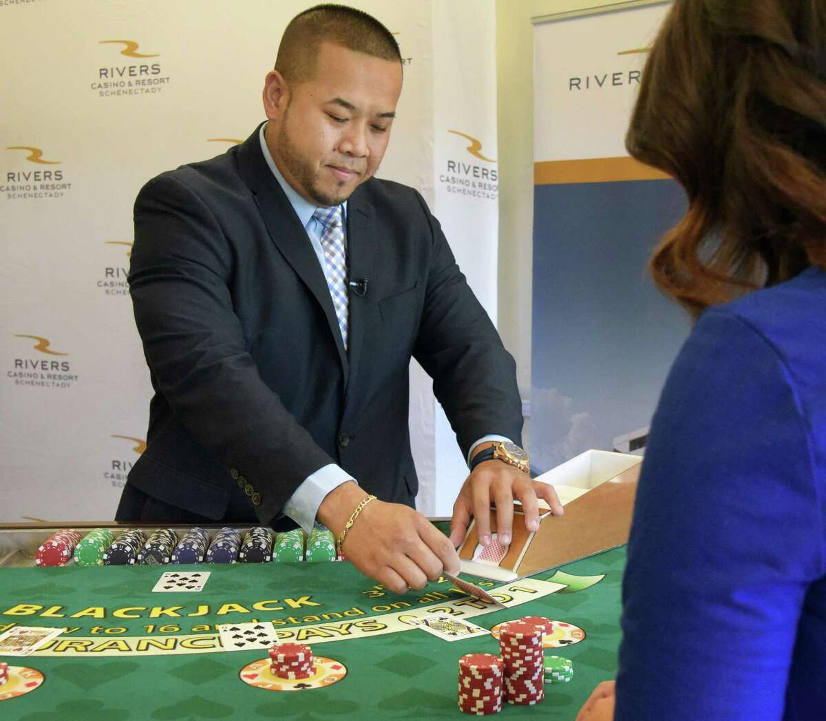 Table games shift manager David Vatthanavong deals blackjack at the Rivers Casino's dealer school during a news conference Thursday Sept. 15, 2016 in Schenectady, NY. (John Carl D'Annibale / Times Union)