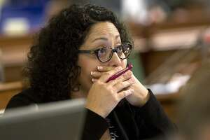 Assemblywoman Cristina Garcia, D-Bell Gardens, watches as the votes are posted for a measure before the Assembly, Thursday, Aug. 18, 2016, in Sacramento, Calif. The Senate approved Garcia's bill, AB1561, Thursday, to repeal the sales tax on tampons and other feminine hygiene products. The bill now returns to the Assembly. (AP Photo/Rich Pedroncelli)