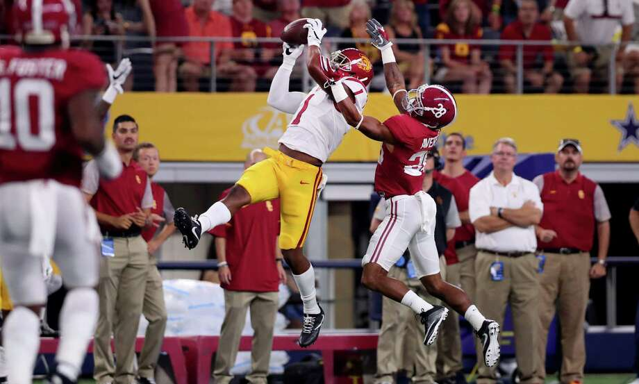 Darreus Rogers of the USC Trojans catches a pass against Anthony Averett of the Alabama Crimson Tide on Sert. 3. On the first weekend of the 2016 college football season, there were 133 college football games broadcast on TV or streamed online stretched across five days including a rare Sunday night college football broadcast. Photo: Tom Pennington / / 2016 Getty Images