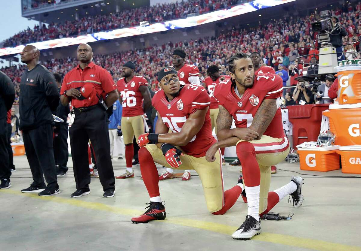 San Francisco 49ers safety Eric Reid (35) and quarterback Colin Kaepernick (7) kneel during the national anthem before a game against the Los Angeles Rams in Santa Clara, Calif., on Sept. 12, 2016.