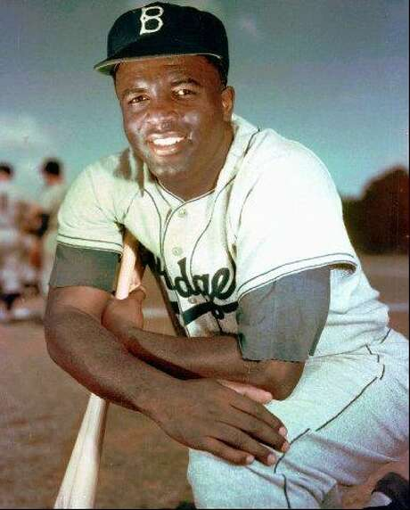 Brooklyn Dodgers' legend Jackie Robinson poses in 1952. Photo: Associated Press File Photo