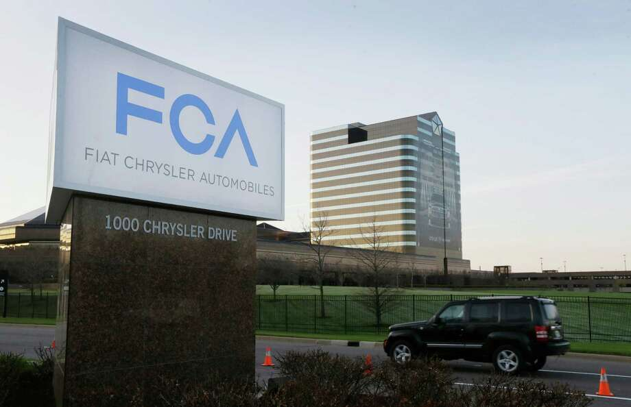 Fiat Chrysler Automobiles is recalling more than 1.9 million vehicles worldwide because an air-bag and seat-belt control module with a certain wiring design may not deploy the air bags or tighten the seat belts if the vehicle is involved in a frontal crash. That could increase the risk of injury. Photo: Associated Press /File Photo / AP