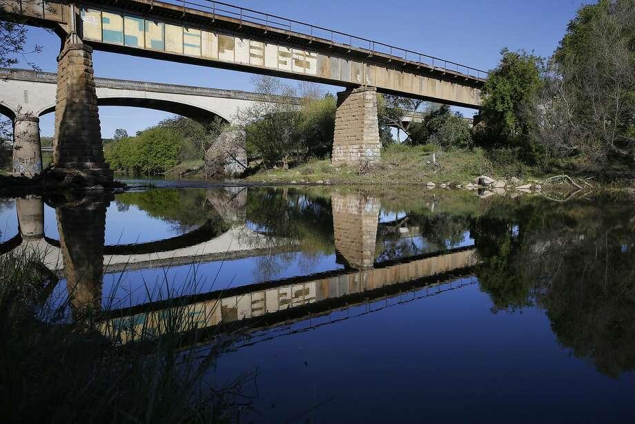 The waters of the Tuolumne River run through Modesto. Photo: Michael Macor, The Chronicle