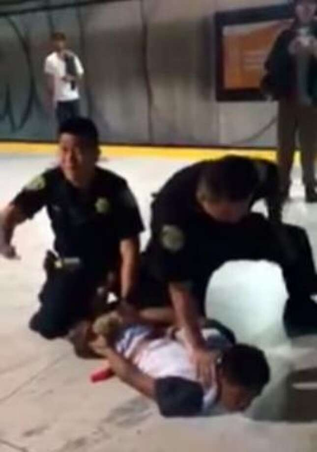 Frame grab from cell-phone footage of BART police officers' arrest of Michael Smith at the Embarcadero Station in San Francisco on July 29, 2016. Photo: Tarina Larsen