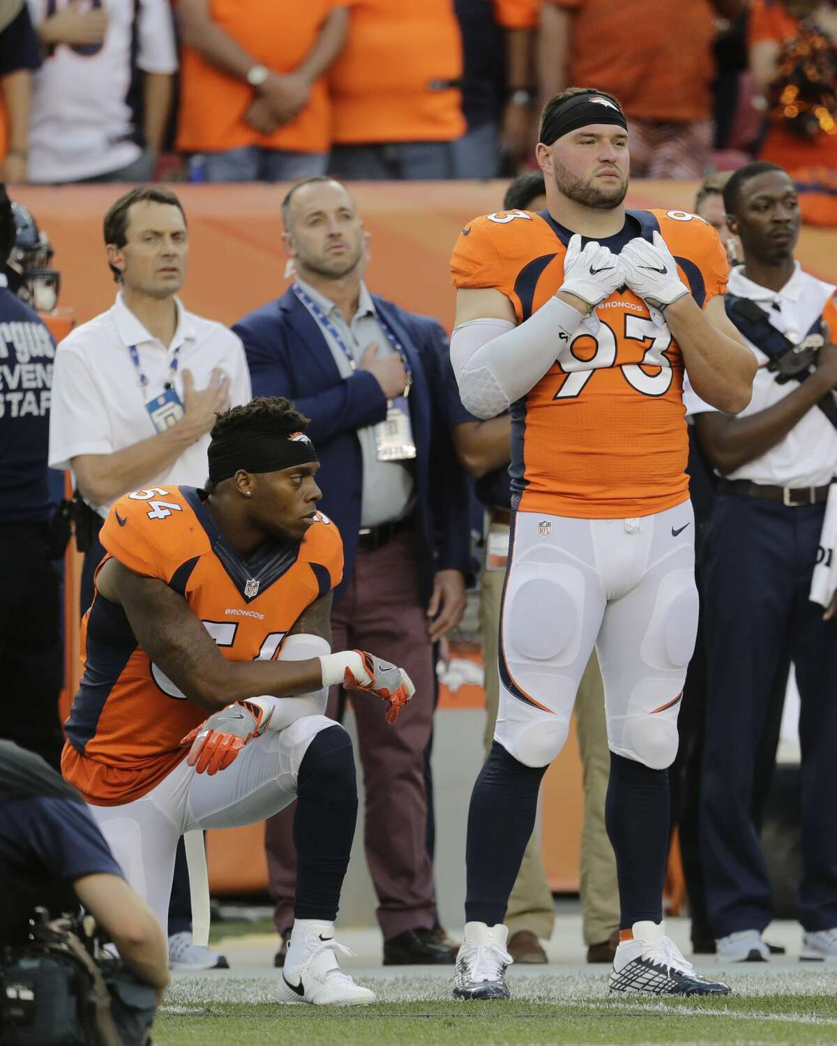 FILE - In this Thursday, Sept. 8, 2016, file photo, Denver Broncos inside linebacker Brandon Marshall (54) kneels on the sideline during the national anthem before an NFL football game against the Carolina Panthers in Denver. The dozen NFL players who have joined Kaepernick?'s protest of social injustices by kneeling or raising a fist during the national anthem have faced vitriolic, sometimes racist reactions on social media and at least one has lost endorsements. None are deterred by the backlash. (AP Photo/Joe Mahoney, File)