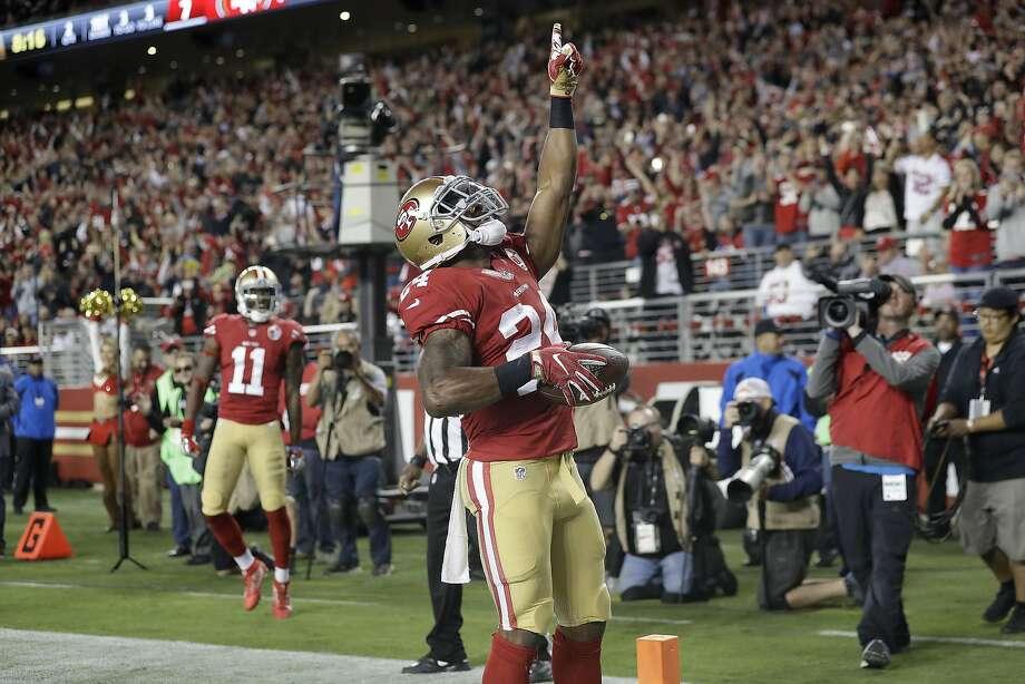 Shaun Darughn celebrates after scoring a three-yard touchdown Monday. Photo: Marcio Jose Sanchez, Associated Press