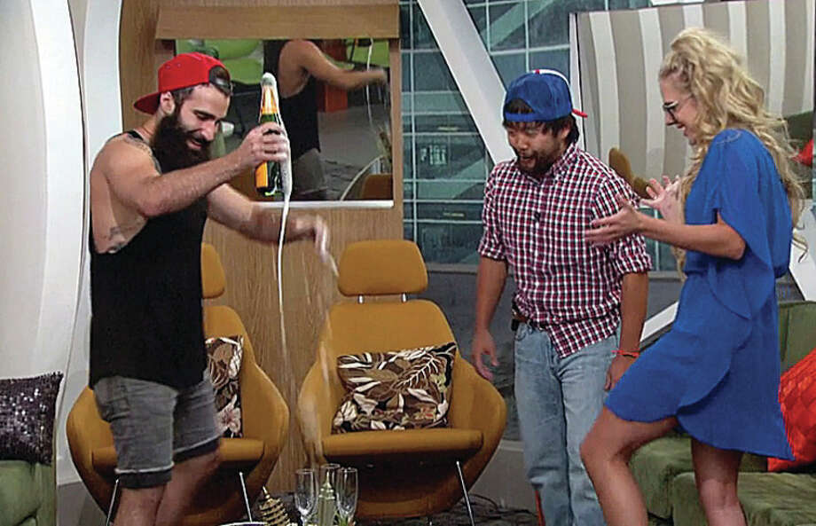 Paul (left), James (center) and Ubly's Nicole Franzel celebrate with a bottle of champagne after becoming the final three houseguests on CBS's hit TV series, Big Brother. The winner will take home $500,000 at the live season finale on Sept. 21. (Photo courtesy of CBS)