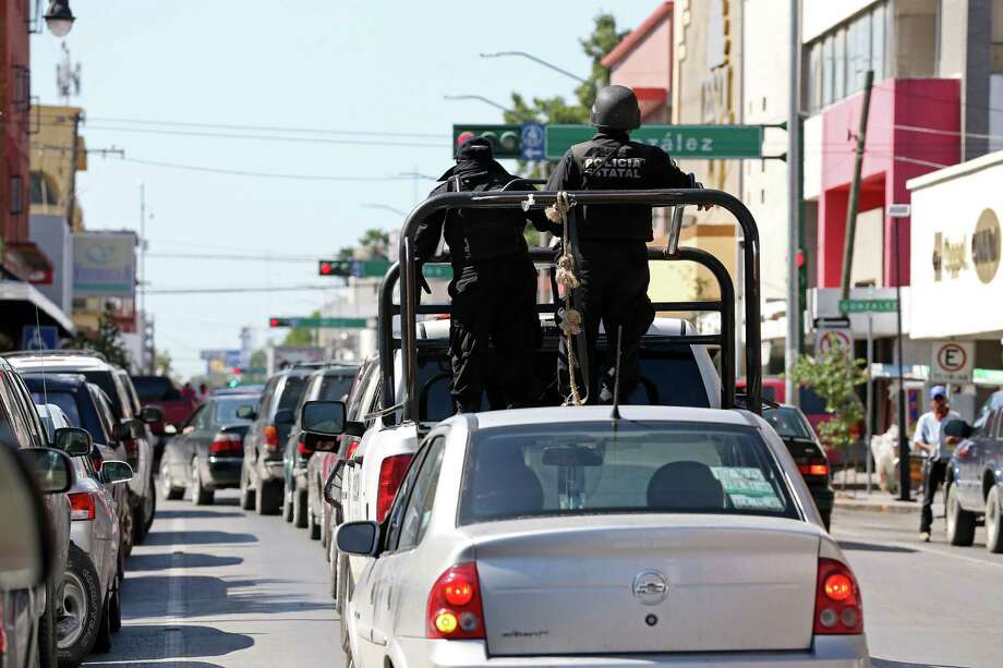 The Tamaulipas State Police patrols the downtown streets of Nuevo Laredo, Mexico, Wednesday, August 25, 2016. A spate of violence has erupted throughout section of Nuevo Laredo as drug cartels fight for control. The Tamaulipas State Police and the Mexican Army are collaborating and patrol the city's streets in an attempt to bring calm to the area. Photo: JERRY LARA, Staff / San Antonio Express-News / © 2016 San Antonio Express-News