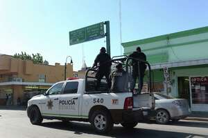 The Tamaulipas State Police patrols the downtown streets of Nuevo Laredo, Mexico, Wednesday, August 25, 2016. A spate of violence has erupted throughout section of Nuevo Laredo as drug cartels fight for control. The Tamaulipas State Police and the Mexican Army are collaborating and patrol the city's streets in an attempt to bring calm to the area.