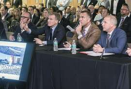 Andy Abboud, left, Las Vegas Sands' senior vice president of government affairs, Rob Goldstein, president and CEO of LVS, Bill Rhoda, president of Legends Global Planning, and Marc Badain, Oakland Raiders president, address the Southern Nevada Tourism Infrastructure Committee discusses finance of the proposed Raiders NFL football stadium on Thursday, Aug. 25, 2016, in Las Vegas. (Jeff Scheid/Las Vegas Review-Journal via AP)