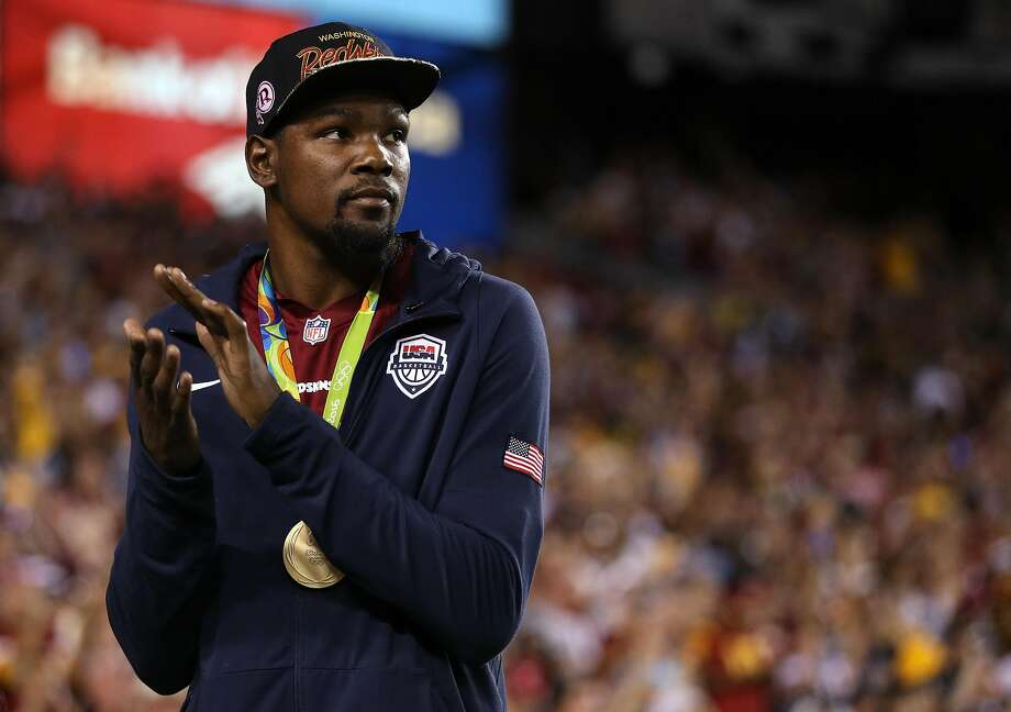 LANDOVER, MD - SEPTEMBER 12: Gold medalist basketball player Kevin Durant of the United States acknowledges the crowd during a game between Pittsburgh Steelers and the Washington Redskins FedExField on September 12, 2016 in Landover, Maryland. (Photo by Patrick Smith/Getty Images) Photo: Patrick Smith, Getty Images