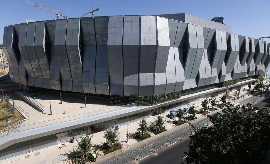 Construction workers put the finishing touches on the Golden 1 Center arena in Sacramento in mid-September. The new home of the Sacramento Kings is the most technologically advanced venue in the sports and entertainment industry. Photo: Paul Chinn, The Chronicle
