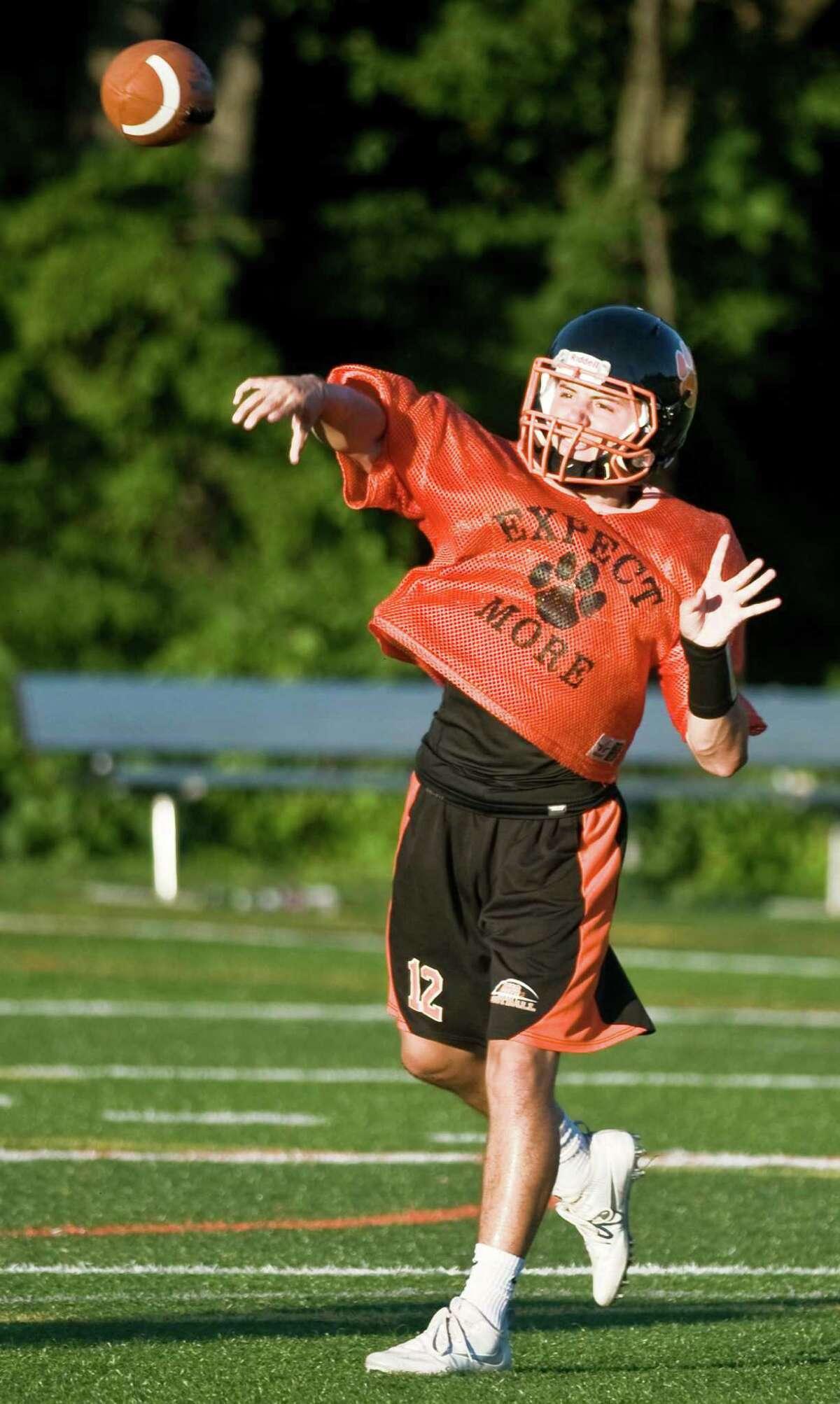 Quarterback Drew Fowler, a senior, firing a pass during a Ridgefield High School football practice. Friday, Aug. 19, 2016