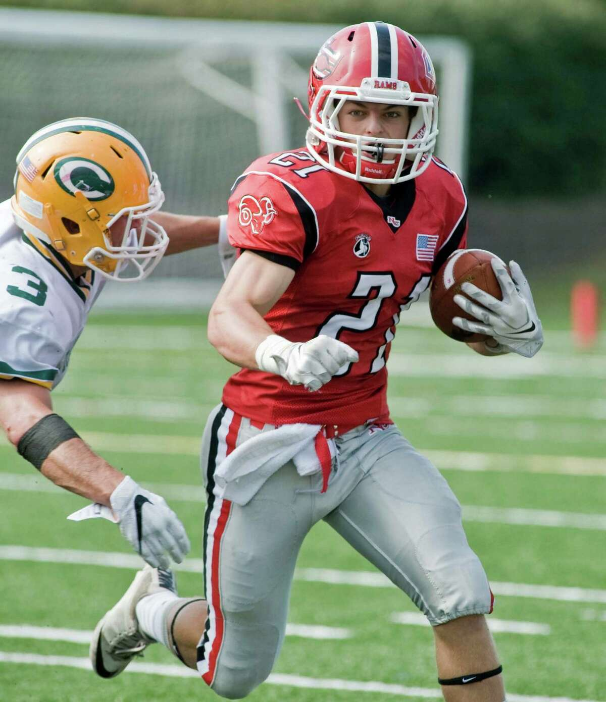 New Canaan High School's Graham Braden carries the ball in a game against Trinity Catholic High School, played at New Canaan. Saturday, Sept. 10, 2016