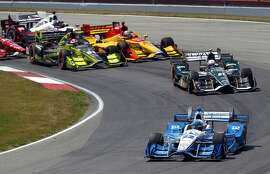 Simon Pagenaud, of France leads the field after taking the green flag during the IndyCar Honda Indy 200 auto race Sunday, July 31, 2016, at Mid-Ohio Sports Car Course in Lexington, Ohio. (AP Photo/Tom E. Puskar)