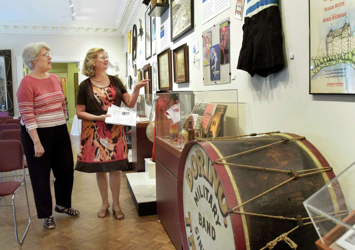 Curator Stacy Pomeroy Draper, left, and executive director Karin Krasevac-Lenz look over the Rensselaer County Historical Society's next bicentennial exhibit
