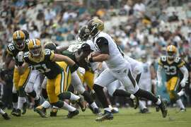 Jacksonville Jaguars quarterback Blake Bortles (5) rushes for yardage past Green Bay Packers outside linebacker Kyler Fackrell (51) during the second half of an NFL football game in Jacksonville, Fla., Sunday, Sept. 11, 2016. The Packers won 27-23. (AP Photo/Phelan M. Ebenhack)