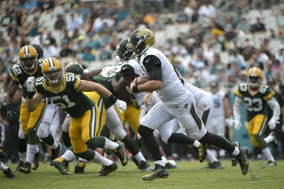Jacksonville Jaguars quarterback Blake Bortles (5) rushes for yardage past Green Bay Packers outside linebacker Kyler Fackrell (51) during the second half of an NFL football game in Jacksonville, Fla., Sunday, Sept. 11, 2016. The Packers won 27-23. (AP Photo/Phelan M. Ebenhack) Photo: Phelan M. Ebenhack, Associated Press