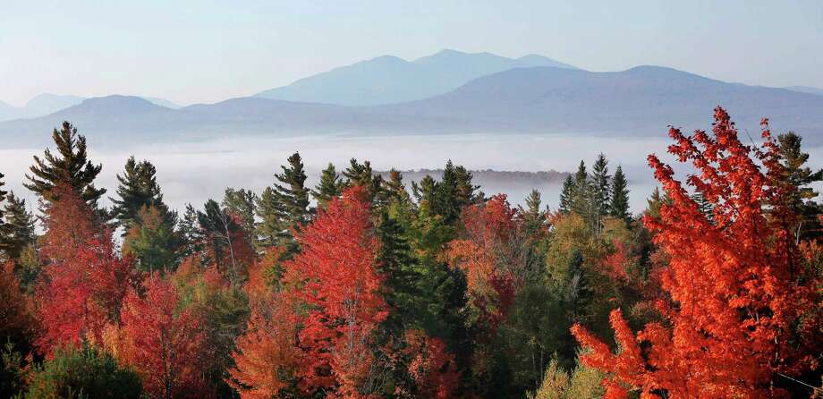Fog sits in the valley of the White Mountains as leaves change colors from Milan Hill in Milan, N.H. Photo: Jim Cole /Associated Press / Copyright 2016 The Associated Press. All rights reserved.