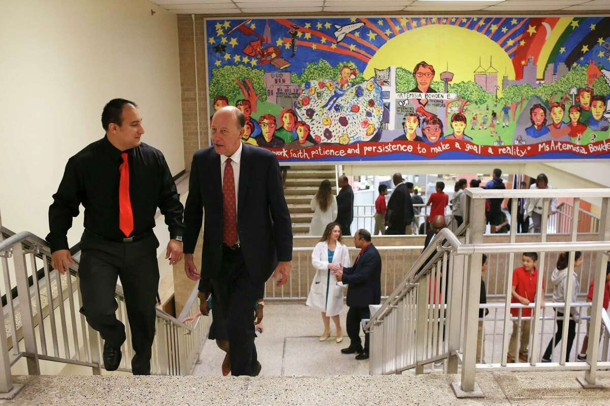 Bowden Elementary School Instructional Dean Rick Senjedo (left) gives a tour of the campus to Johan Uvin, a top official in the U.S. Department of Education, during a back-to-school bus tour.