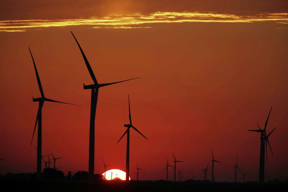 The silhouette of wind turbines, operated by Pattern Energy Group Inc., stand while the sun sets at the Amazon Wind Farm Fowler Ridge, operated by Pattern Energy Group Inc., in Fowler, Indiana, U.S., on Wednesday, Aug. 3, 2016. Pattern Energy Group Inc.'s quarterly earnings was released on Aug. 5. Photographer: Luke Sharrett/Bloomberg