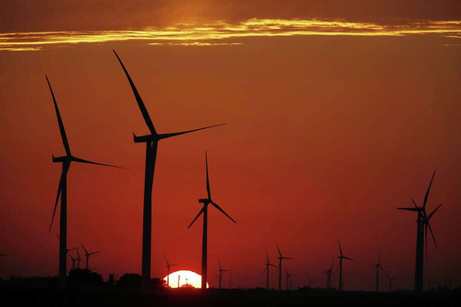 The silhouette of wind turbines, operated by Pattern Energy Group Inc., stand while the sun sets at the Amazon Wind Farm Fowler Ridge, operated by Pattern Energy Group Inc., in Fowler, Indiana, U.S., on Wednesday, Aug. 3, 2016. Pattern Energy Group Inc.'s quarterly earnings was released on Aug. 5. Photographer: Luke Sharrett/Bloomberg Photo: Luke Sharrett / © 2016 Bloomberg Finance LP