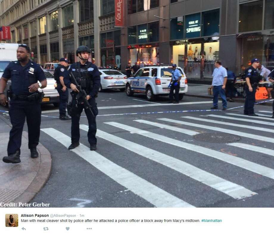 Allison Papson ‏@AllisonPapson 1m1 minute ago  Man with meat cleaver shot by police after he attacked a police officer a block away from Macy's midtown. #Manhattan Photo: Twitter Screen Shots