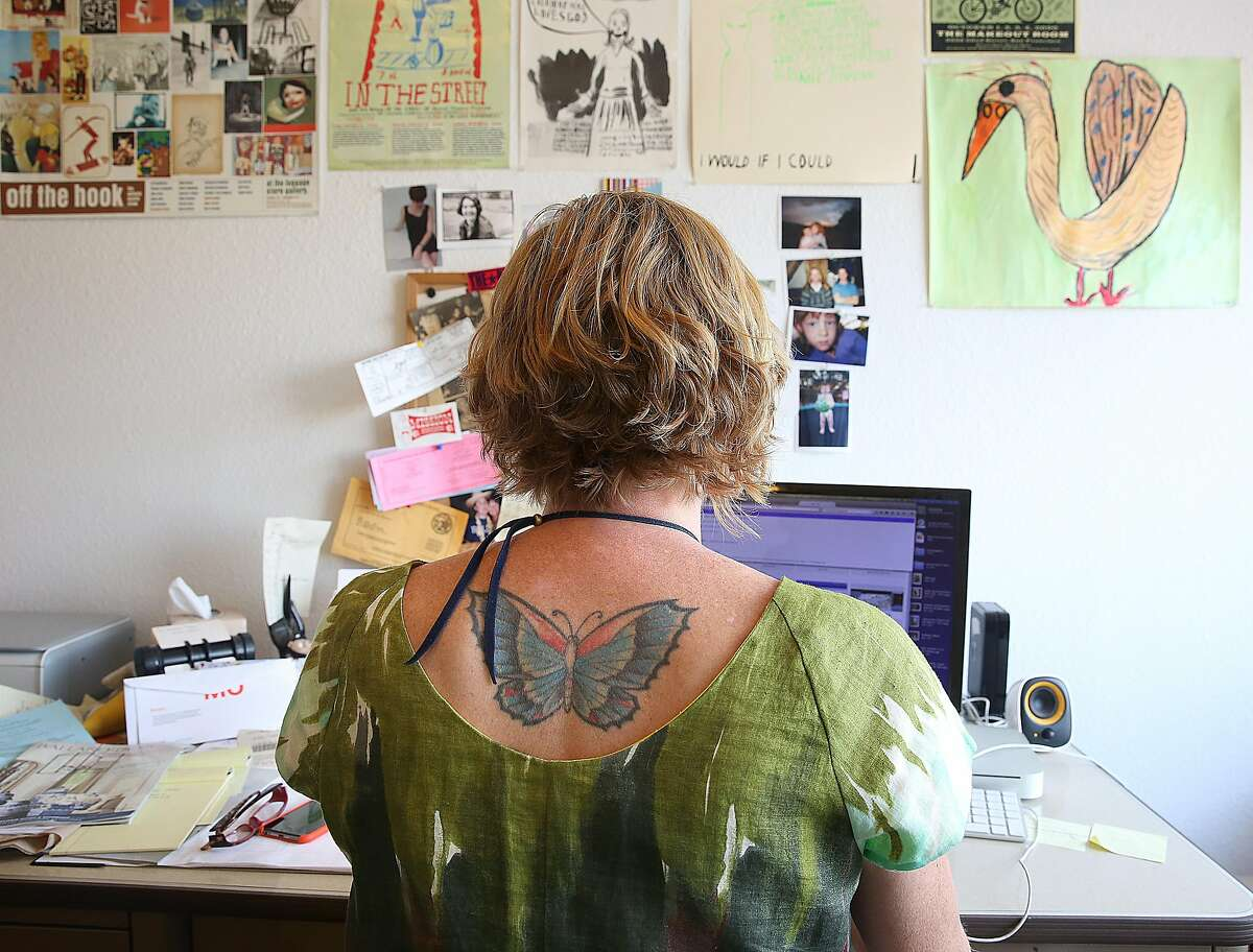 Clothing designer Dema Grim works on her website in her downtown studio on Tuesday, September 13, 2016, in San Francisco, Calif.