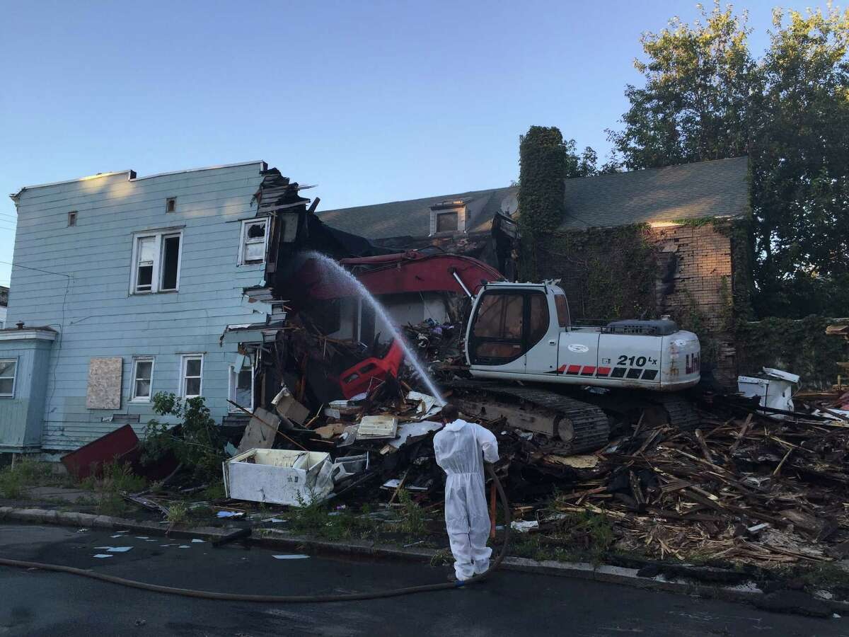 A three-family home at 66 N. Lake Ave. in Albany is demolished on Thursday, Sept. 15, 2016. (Amanda Fries / Times Union)
