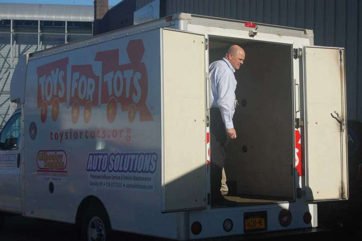 IntegraOptics Dave Prescott, president of IntegraOptics, is ready to help load a Toys for Tots van in Latham.