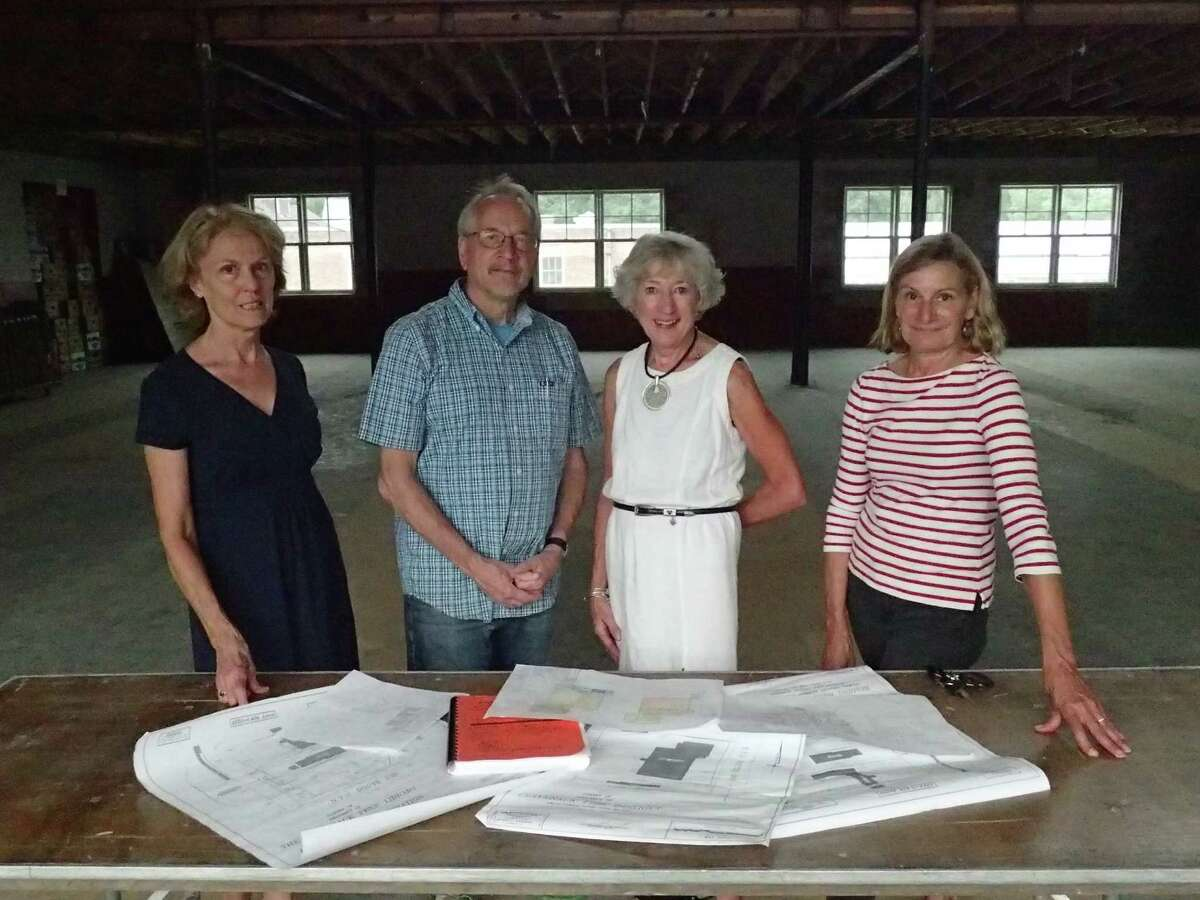 Claverack Library trustees review plans for the new library, from left, board treasurer Susan Roberts, new library committee member Stephen King, board president Jane Case, and board secretary Jennifer Post. (Submitted photo)