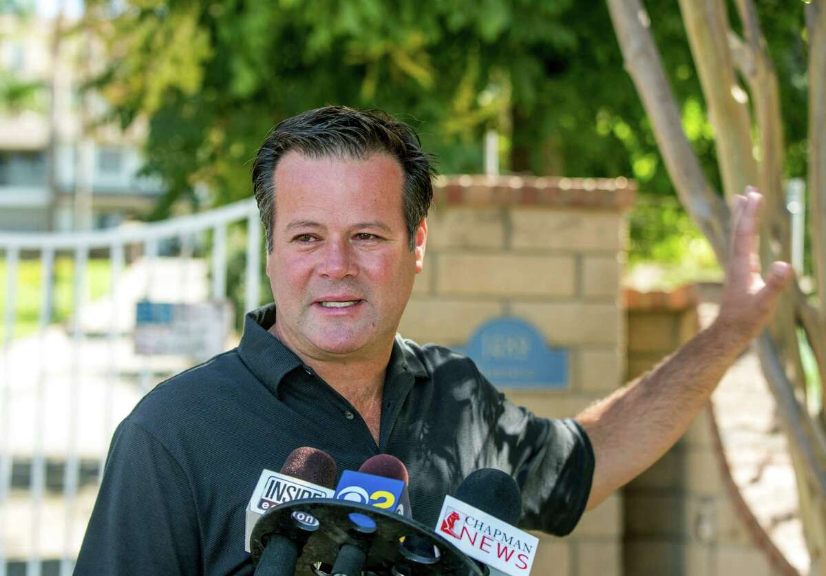 Former NASCAR racer Robby Gordon makes a statement to members of the media gathered outside his home in Orange, Calif., on Thursday, Sept. 15, 2016. Gordon said his family is in shock and grieving the loss of his father and stepmother, who were found dead inside their Southern California home. (AP Photo/Damian Dovarganes) ORG XMIT: CADD105