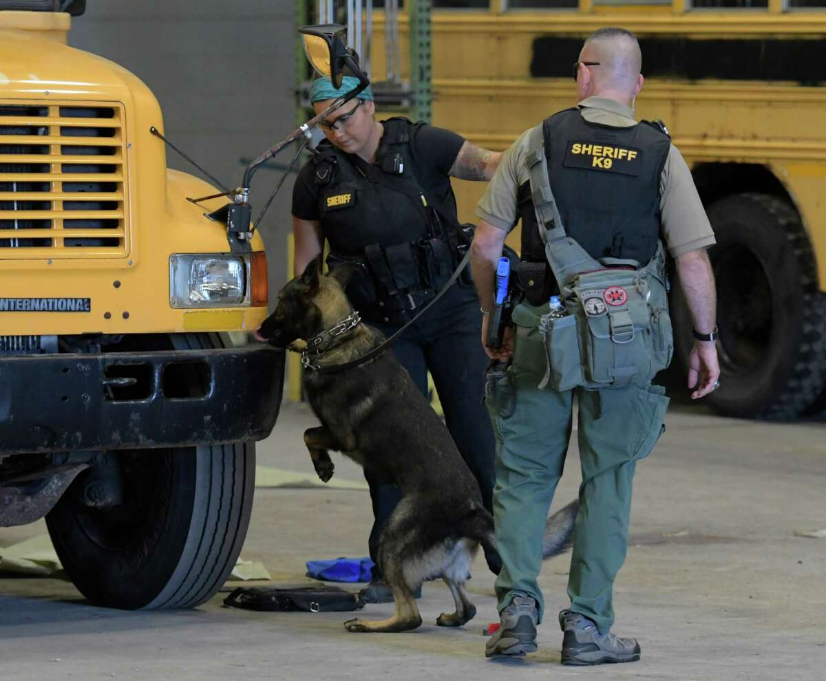 Members of the Albany County Sheriff K-9 unit search a school bus during an active terrorist scenario during training at the Division of Homeland Security & Emergency Services State Preparedness Training Center on Thursday, Sept. 15, 2016, in Oriskany, N.Y. (Skip Dickstein/Times Union)