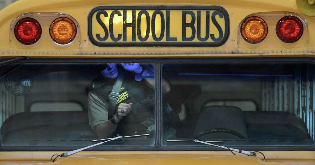 Deputy Joe Martel of the Albany County Sheriff's K-9 unit searches a school bus during an active terrorist scenario during training at the Division of Homeland Security & Emergency Services State Preparedness Training Center on Thursday, Sept. 15, 2016, in Oriskany, N.Y. (Skip Dickstein/Times Union)