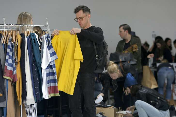 "Tim Carlson shops the Le Point rack at ""The Big Deal"" a clothing stock sale from seven boutiques including Le Point on Saturday, September 10, 2016, at 1417 15th Street in San Francisco, Calif.   Seven female-owned  local high-end boutiques participated in a clothing stock sale--Acrimony, Ali Golden, Freda Salvador, Half Hitch Goods, Le Point, Mira Mira, The Merchant Home, The Podolls."
