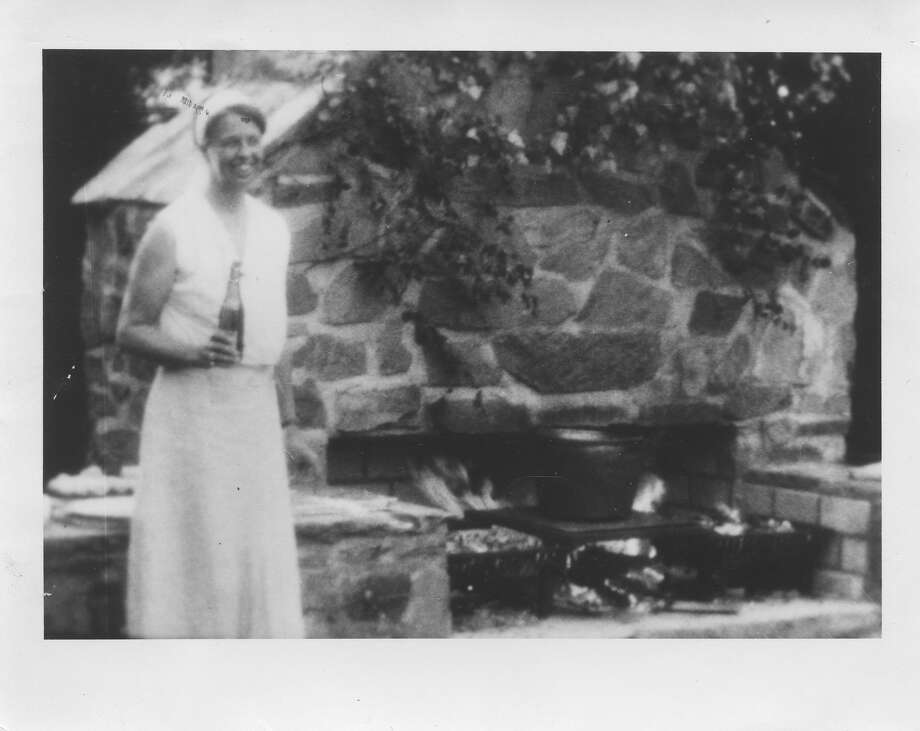 Eleanor Roosevelt stands in front of the now restored outdoor fireplace. (Photo by Nancy Dickerman)