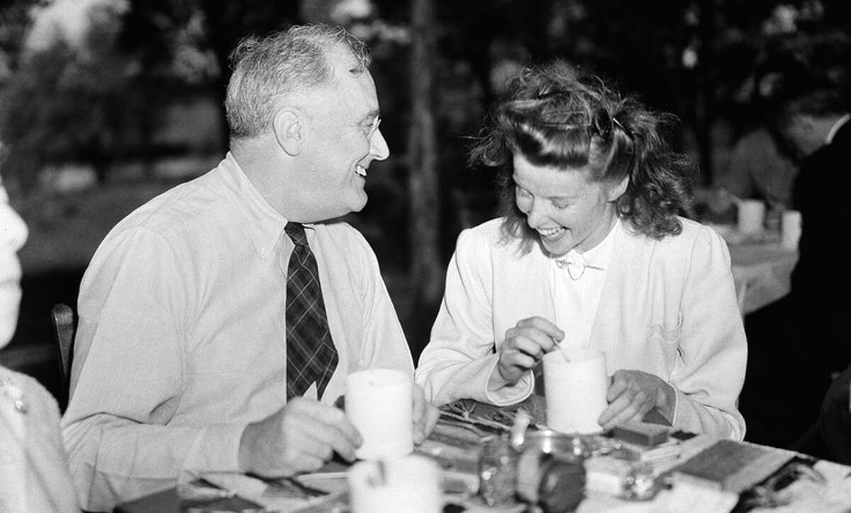 President Franklin D. Roosevelt, left, and actress Katharine Hepburn at the president's Hyde Park, N.Y., estate on Sept. 22, 1940. Nearly a score of authors and playwrights were guests of the president and they pledged their support to a third term for the chief executive. (AP Photo/Henry Griffin)