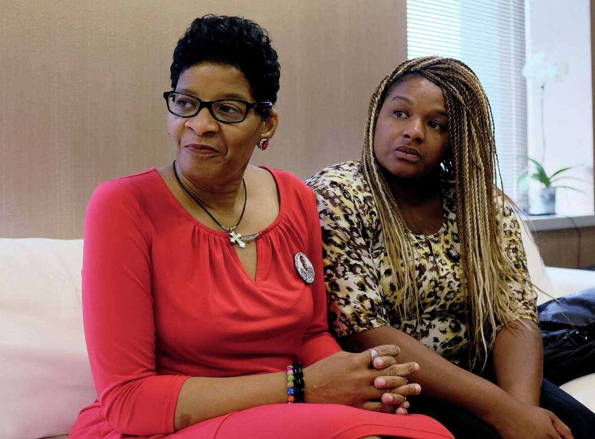 Geneva Reed-Veal, left, mother of Sandra Bland, a black Chicago-area woman who died in a Texas jail after a contentious traffic stop last summer, waits with her daughter Shavon Bland in the family's attorney's office, Thursday, Sept. 15, 2016, in Chicago. Bland died in her cell at the Waller County Jail three days after she was arrested by a white Texas state trooper for a minor traffic offense in July 2015. Her death was ruled a suicide, and Bland's family later sued the county and the Texas Department of Public Safety. (AP Phoro/Kiichiro Sato)