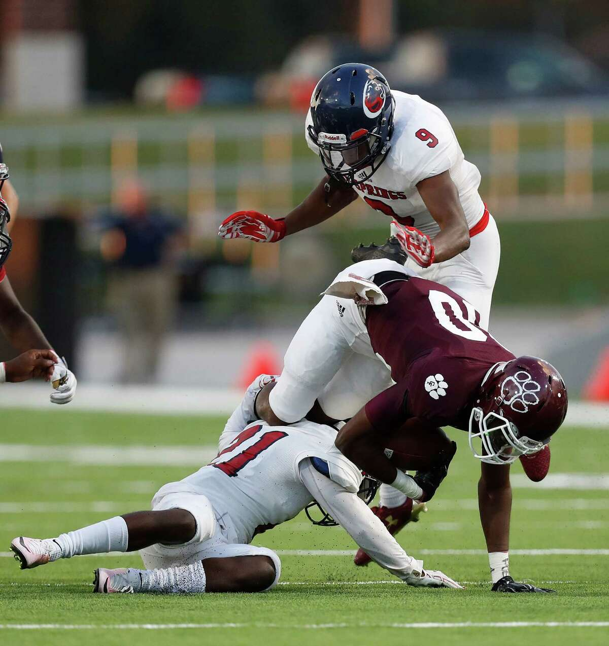 Cy-Fair's B.J. Chambers (80) dives over Cypress Spring's Brandon Wilson (21) during the first half of the Cy Springs vs. Cy-Fair high school football game at Pridgeon Stadium, Thursday, Sept. 15, 2016 in Houston.