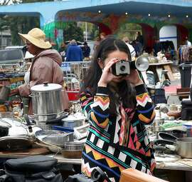 Cameras next to kitchenware at the Alemany Flea Market on Sunday, September 11, 2016, in San Francisco, Calif.